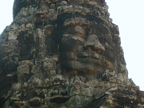 Buddha relief. There are at least 50 buddha faces at this temple, all smiling, 15-20 feet tall