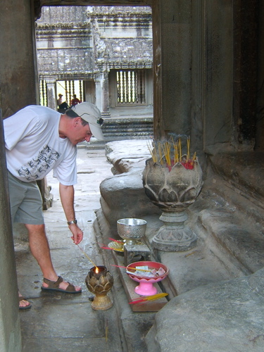 Rob making an offering at an alter in Angkor Wat